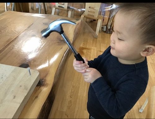 A child holding a hammer