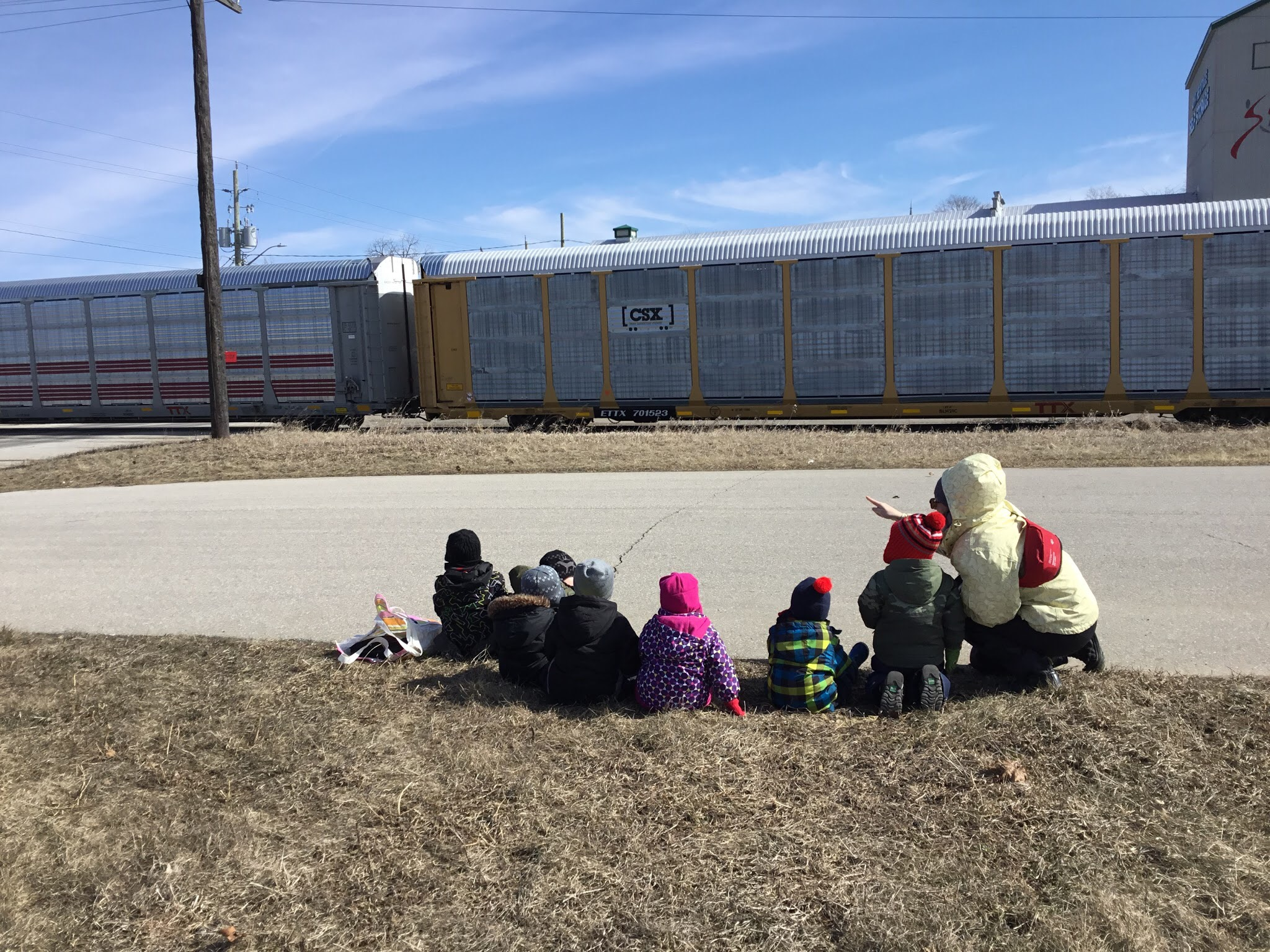 kids watching a train go by
