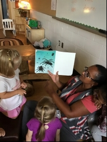 An educator reads with children