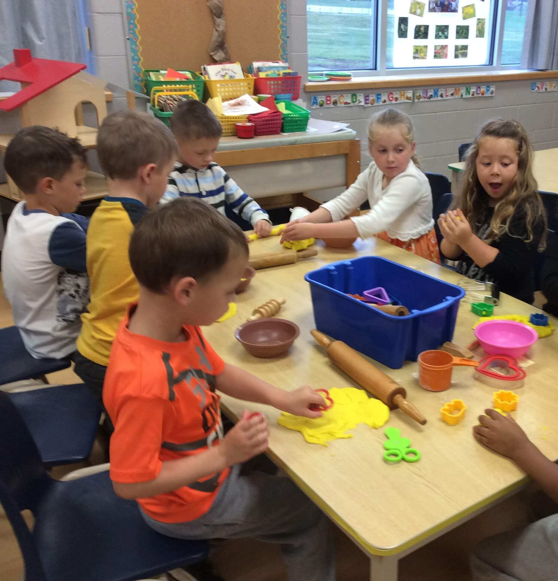 children playing with playdough