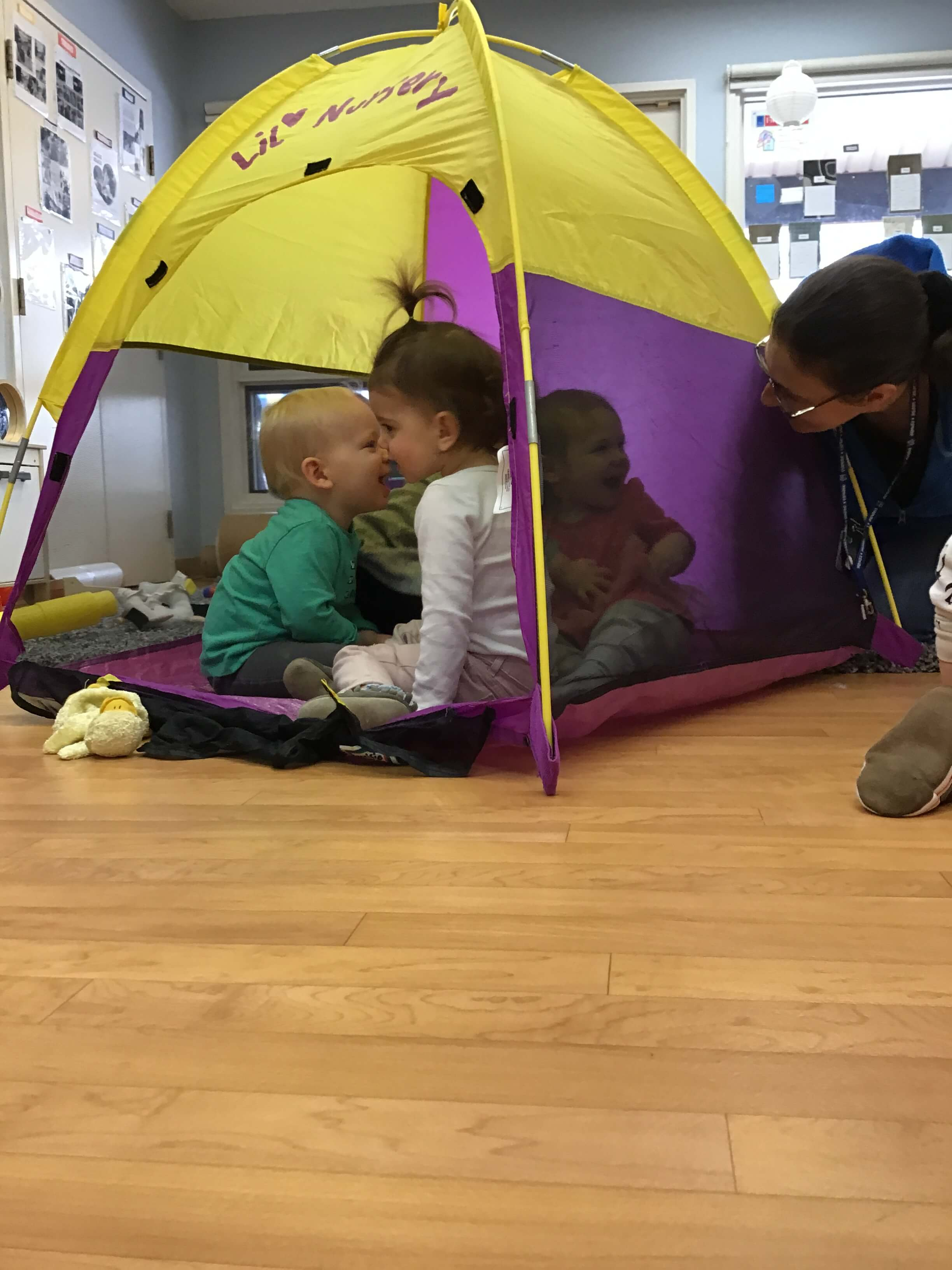 children hiding in a tent
