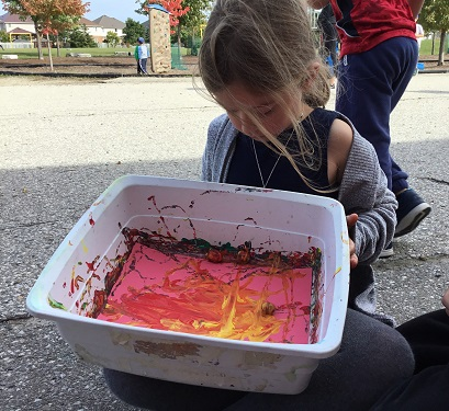 Girl marble painting outside