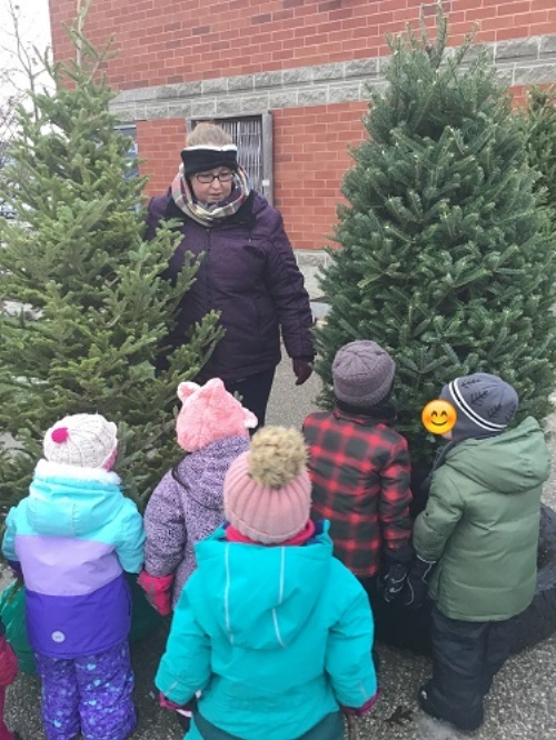 A group of children smell the new trees