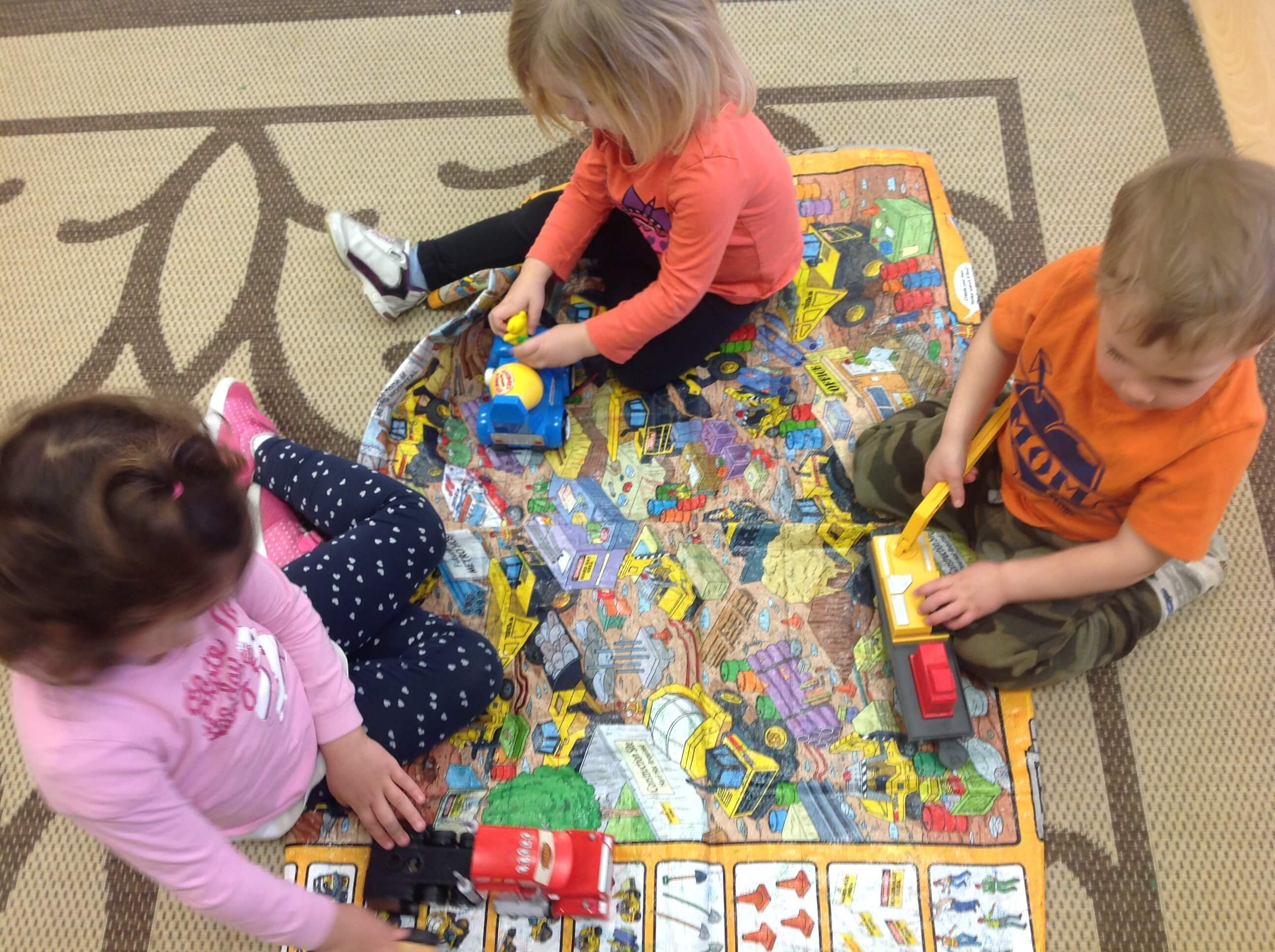 children playing a construction game