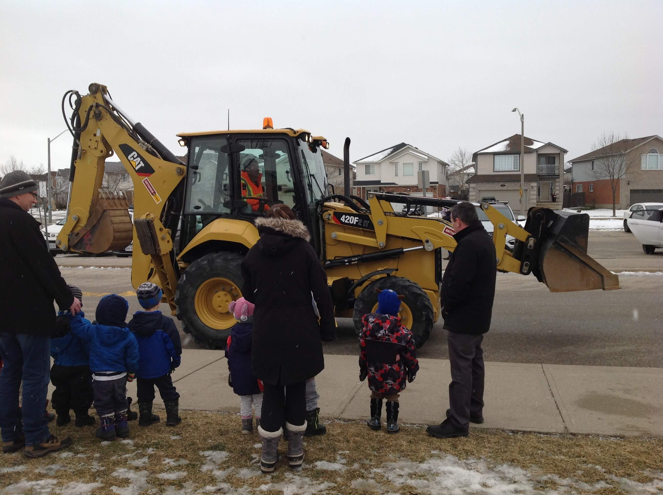 children watching a digger