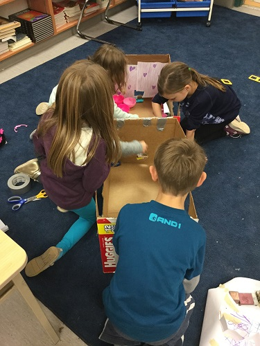 group of children building with cardboard