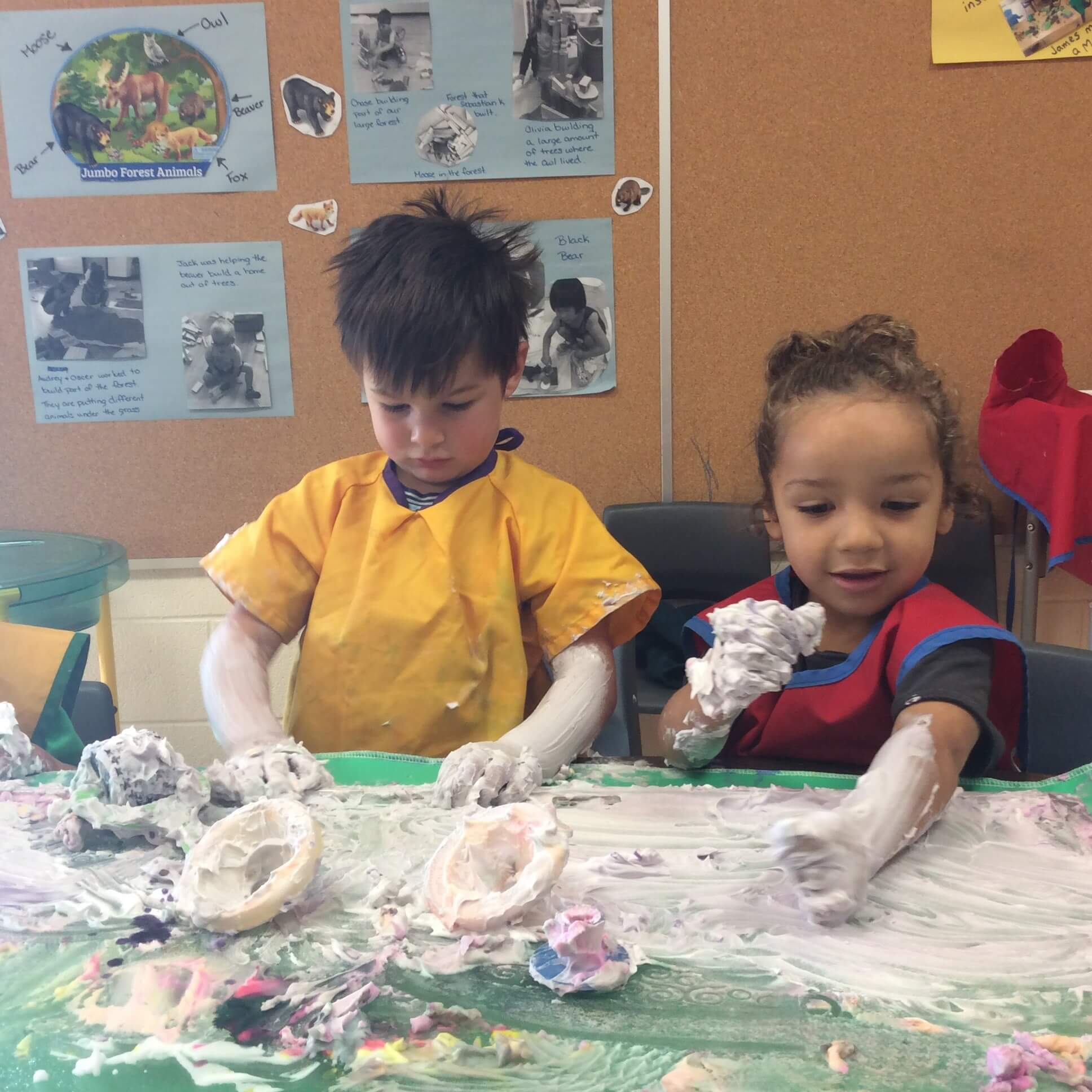 preschoolers playing with shaving cream