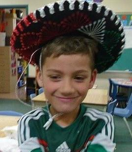 boy wearing a sombrero hat