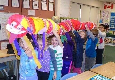 children carying their handmade chinese dragon