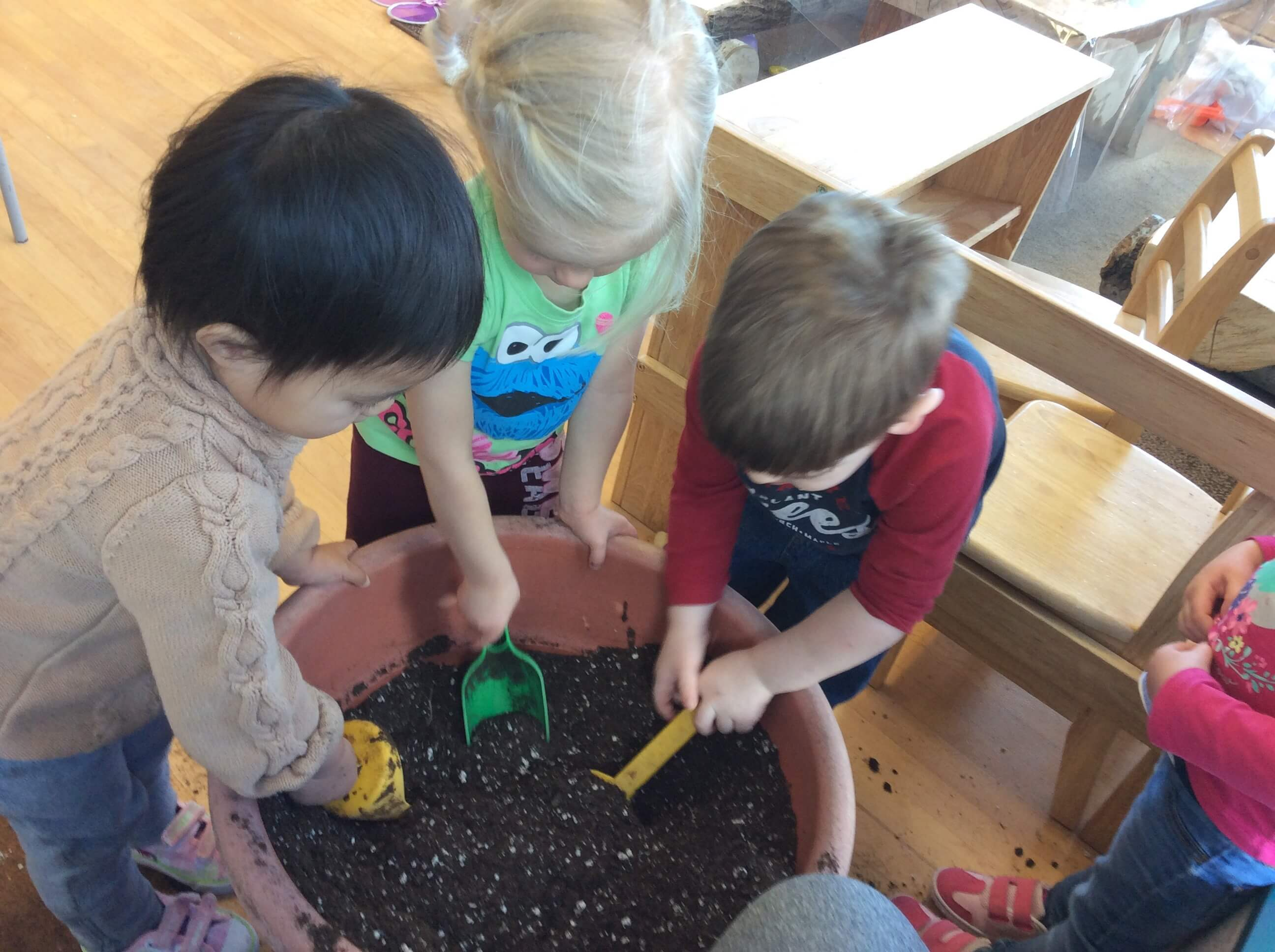 Children planting pumkin seeds