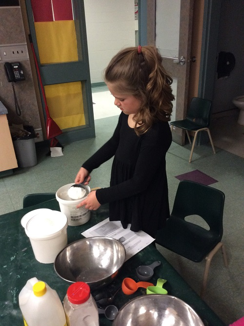 Girl mixing ingredients at table