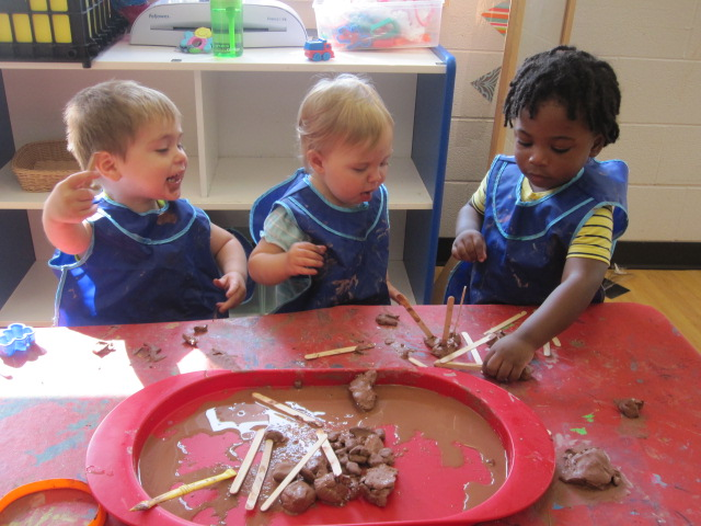 toddlers playing with clay